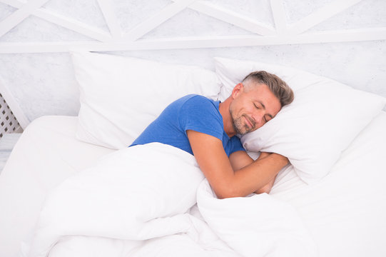 Peaceful mature man relaxing. Good Sleep is Reachable Dream. World Sleep Day. Benefits of good and healthy sleep. Breathe Easily, Sleep Well. Handsome man in bed. Sleeping guy at home. Need more rest