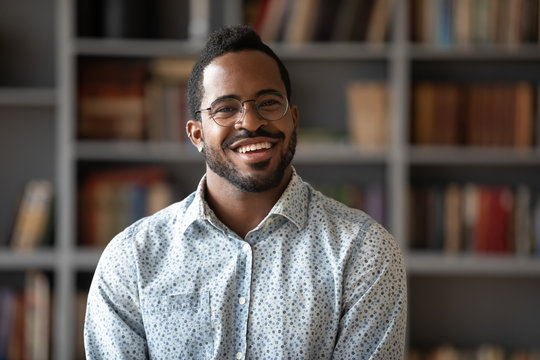 Head shot portrait of happy young african american businessman.