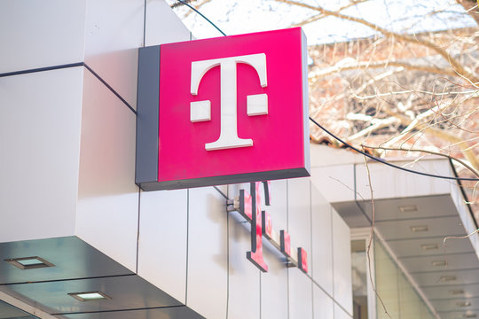 Logo of T-Mobile on the store. T-Mobile is the brand name Deutsche Telekom, founded at 1999.