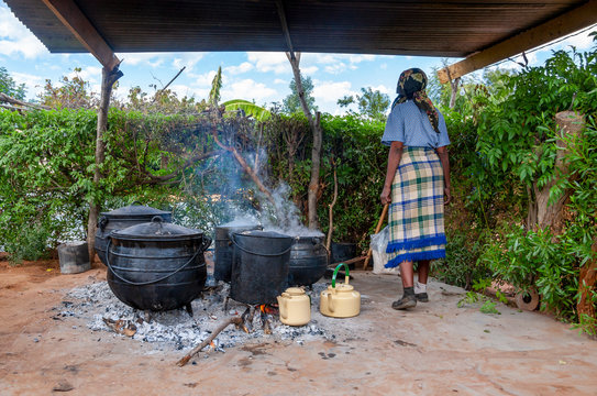 African woman cooking outdoors