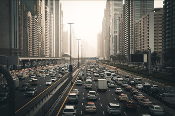 Rush hour with many cars on Dubai city road, traffic jam in downtown. Fotomurales