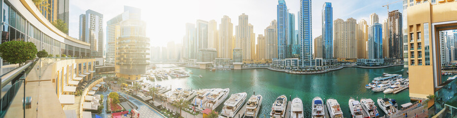 Fotorolgordijn Dubai Dubai Marina panorama in morning sunlight, boats and yachts in water canal with modern skyscrapers buildings.