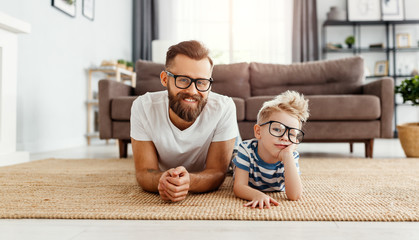 Father's day. Happy funny family son and dad with glasses