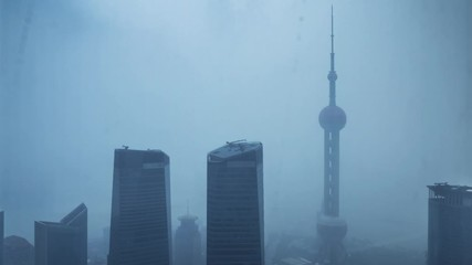 Fotomurales - Shanghai city in stormy rain, view of the skyscrapers of Pudong, China