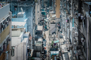 Fototapete - Back alley between apartments in residential area, Kowloon City, Hong Kong, daytime