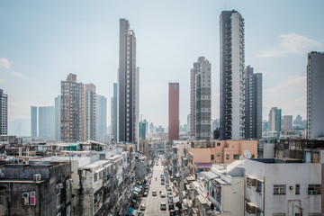 Fotomurales - many cars parked in busy street in residential area , downtown Kowloon City, Hong Kong, daytime