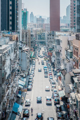 Fototapete - many cars parked in busy street in residential area , downtown Kowloon City, Hong Kong, daytime