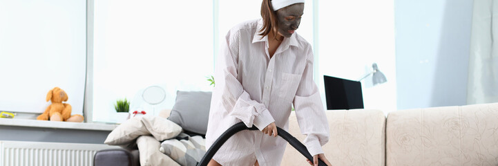 Printed roller blinds Spa Young woman in beauty spa mask using vacuun cleaner against home background. Lifestyle concept