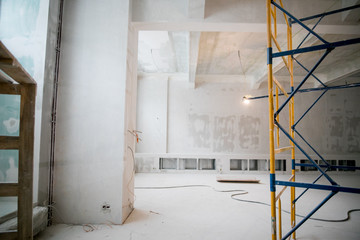 Interior construction of warehouse concrete wall and scaffolding. Fotomurales