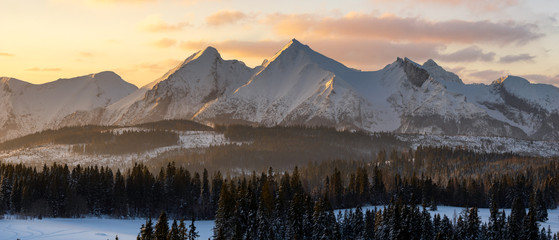 Foto auf Leinwand Beige Snow-covered peaks of the Tatra Mountains in the light of the rising sun