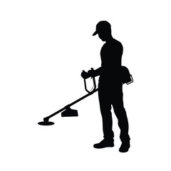 Man and grass mowing equipment silhouette