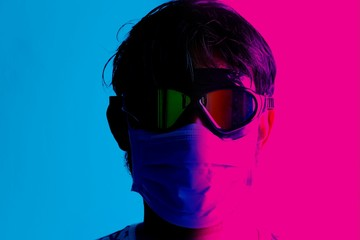 Neon effect picture of man wearing medical mask for viral or pandemic disease