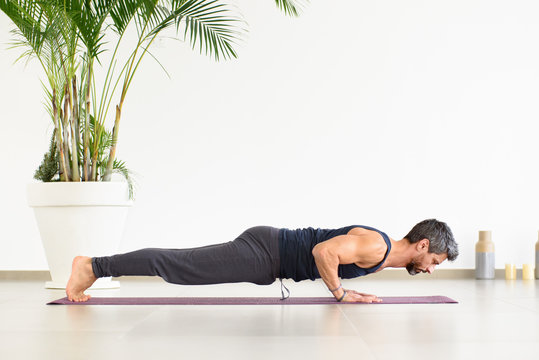 Fit man doing Yoga chaturanga push-ups