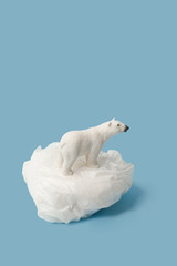 Poster Ours Blanc White polar bear on plastic bag on blue background, plastic pollution and climate change concept