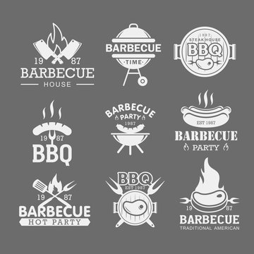 BBQ white logo templates set. Steak house, grilled meat restaurant emblems isolated on grey background pack. Roasted pork, sausage on fork stickers. Barbeque party stickers collection.