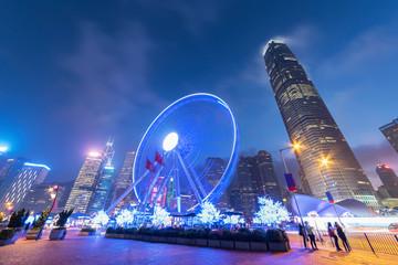 Ferris Wheel in downtown of Hong Kong city at dusk Fotomurales