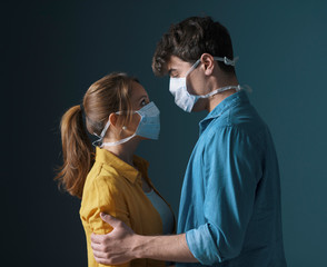 Young loving couple wearing face masks