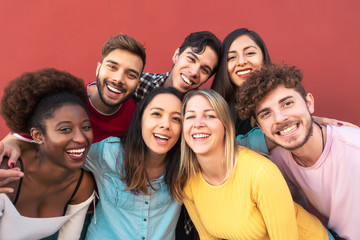 Group multiracial people having fun outdoor - Happy mixed race friends sharing time together -...