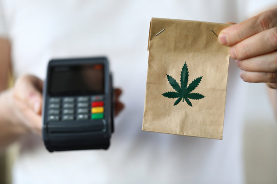 Package delivery with marijuana, payment terminal. Use and storage medical marijuana. Legalized narcotic herb. Treating pain, stress and insomnia. Registered medical hemp delivery agent