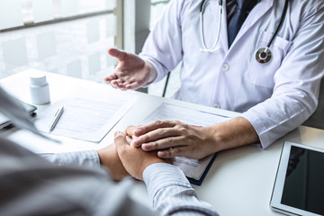 Image of doctor holding patient's hand to encourage, talking with patient cheering and support, healthcare and medical assistant