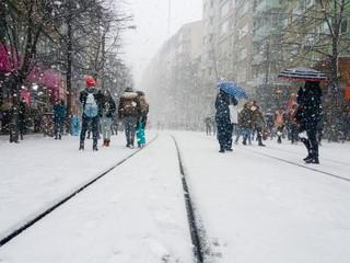 Group of people walking on the snowy street during snowstorm in Eskisehir, Turkey