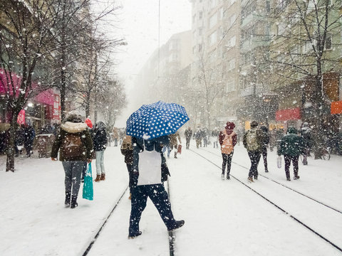 Group of people walking on the snowy street during snowstorm in Eskisehir, Turkey