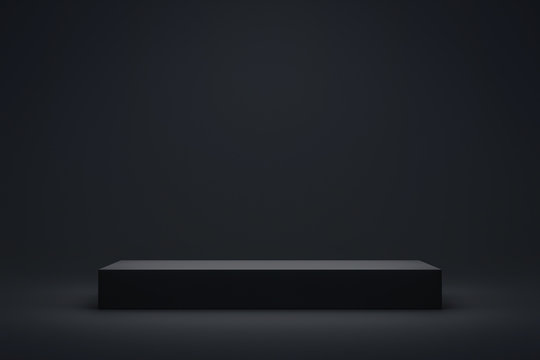 Black podium or pedestal display on dark background with long platform. Blank product shelf standing backdrop. 3D rendering.