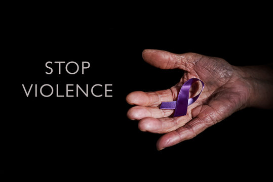 purple ribbon and text stop violence