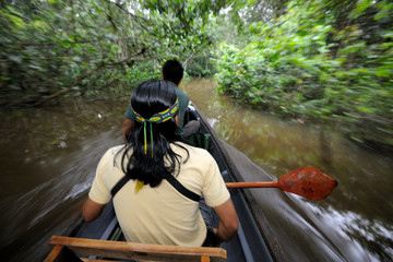 People in a boat on Amazon rainforest river