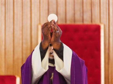 african priest in the altar