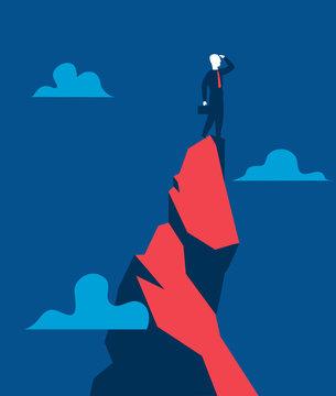 Uomo d'affari su un picco di montagna cerca di vedere sopra l'orizzonte - illustrazione vettoriale
