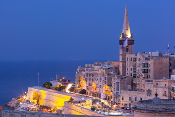 Fototapete - View of Old town roofs and St. Paul's Anglican Pro-Cathedral at night, Valletta, Capital city of Malta