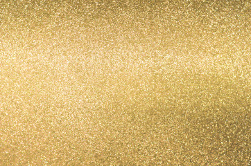 Gold texture background with yellow luxury shiny shine glitter sparkle of bright light reflection on golden surface Wall mural