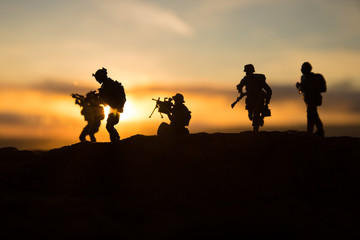 War Concept. Military silhouettes fighting scene on war fog sky background, World War Soldiers Silhouette Below Cloudy Skyline At sunset. Fotobehang