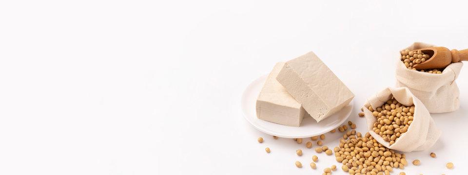 Meat substitute. Pressed firm white tofu blocks.