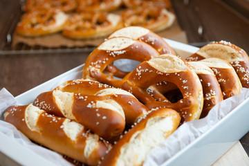 Foto op Canvas Bakkerij Closeup photo of handmade lye bun and pretzel in bakery