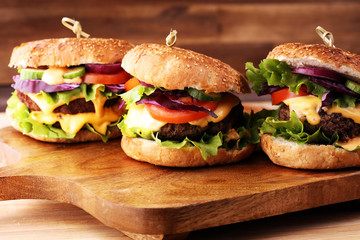 Tasty fresh meat burgers with salad and cheese. Homemade angus burger. Fototapete
