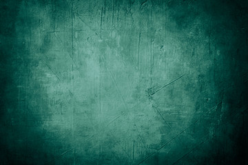 green grunge background or texture with dark vignette borders and spotlight