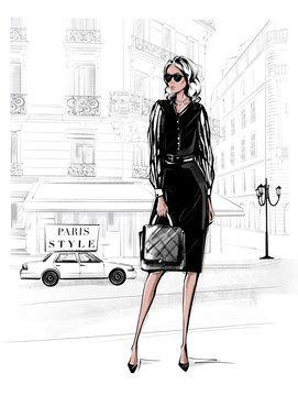 Hand drawn beautiful young woman in black dress. Fashion woman with bag. Girl in black shoes with Paris street background. Sketch. Fashion illustration.
