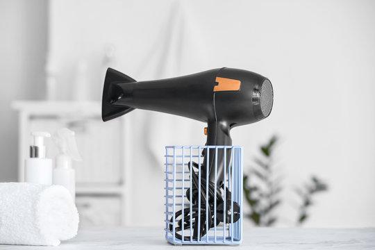 Modern hair dryer on table