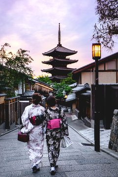 Womans with kimono from back with pagoda and sunset, yasaka, kyoto, japan