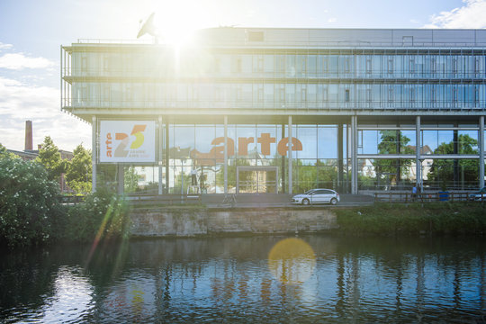 Strasbourg, France - May 19, 2017: Sunlight flare over Headquarter of Franco-German free-to-air television network that promotes cultural programming Arte televisions