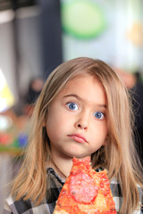 funny, cute girl eating pizza