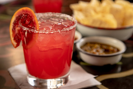 Blood orange margarita with chips and salsa