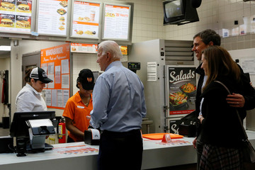 Former U.S. Vice President Joe Biden orders food with former Democratic U.S. presidential candidate Beto O'Rourke and his wife Amy at a Whataburger after O'Rourke endorsed Biden's campaign for president in Dallas