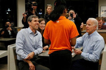 Former U.S. Vice President Joe Biden gives his server a tip as he sits with former Democratic U.S. presidential candidate Beto O'Rourke and his wife Amy at a Whataburger after O'Rourke endorsed Biden's campaign for president in Dallas
