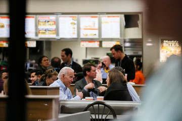 Former U.S. Vice President Joe Biden sits with former Democratic U.S. presidential candidate Beto O'Rourke and his wife Amy at a Whataburger after O'Rourke endorsed Biden's campaign for president in Dallas