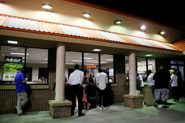 People look through windows as former Democratic U.S. presidential candidate Beto O'Rourke, his wife Amy and former U.S. Vice President Joe Biden visit a Whataburger after O'Rourke endorsed Biden's campaign for president in Dallas