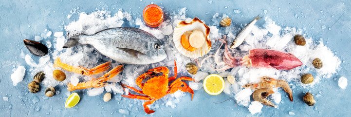 Fish and seafood overhead panoramic shot. Sea bream, scallop, crab, squid, clams and prawns