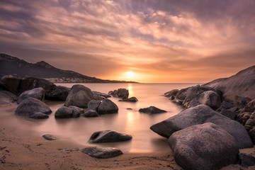 Sunset over beach and village of Algajola in Corsica Fotomurales